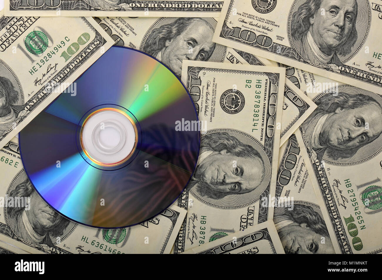 Bank notes, CD, DVD, data protection, tax evasion, pirated copies, etc., Banknoten, Datenschutz, Steuerhinterziehung, Stock Photo
