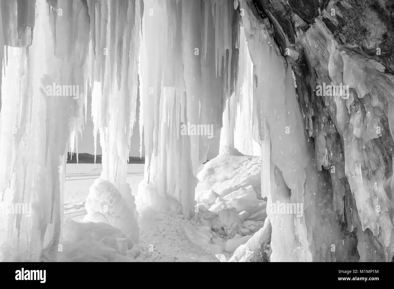Sun shines on an ice column curtain on Grand Island near Munising Michigan in winter - Stock Image