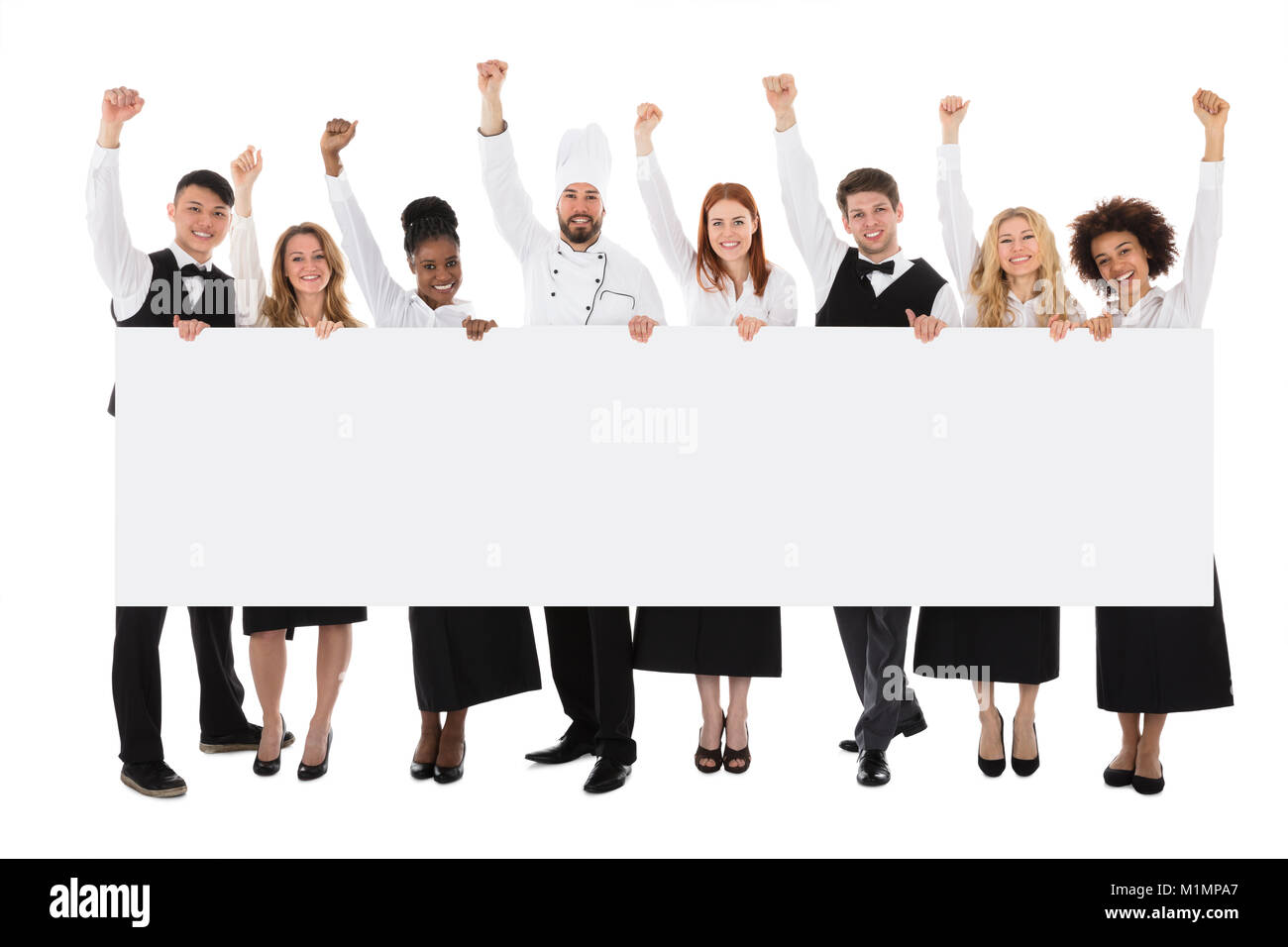 Portrait Of Multiracial Restaurant Staff Holding Billboard Raising Their Arms - Stock Image