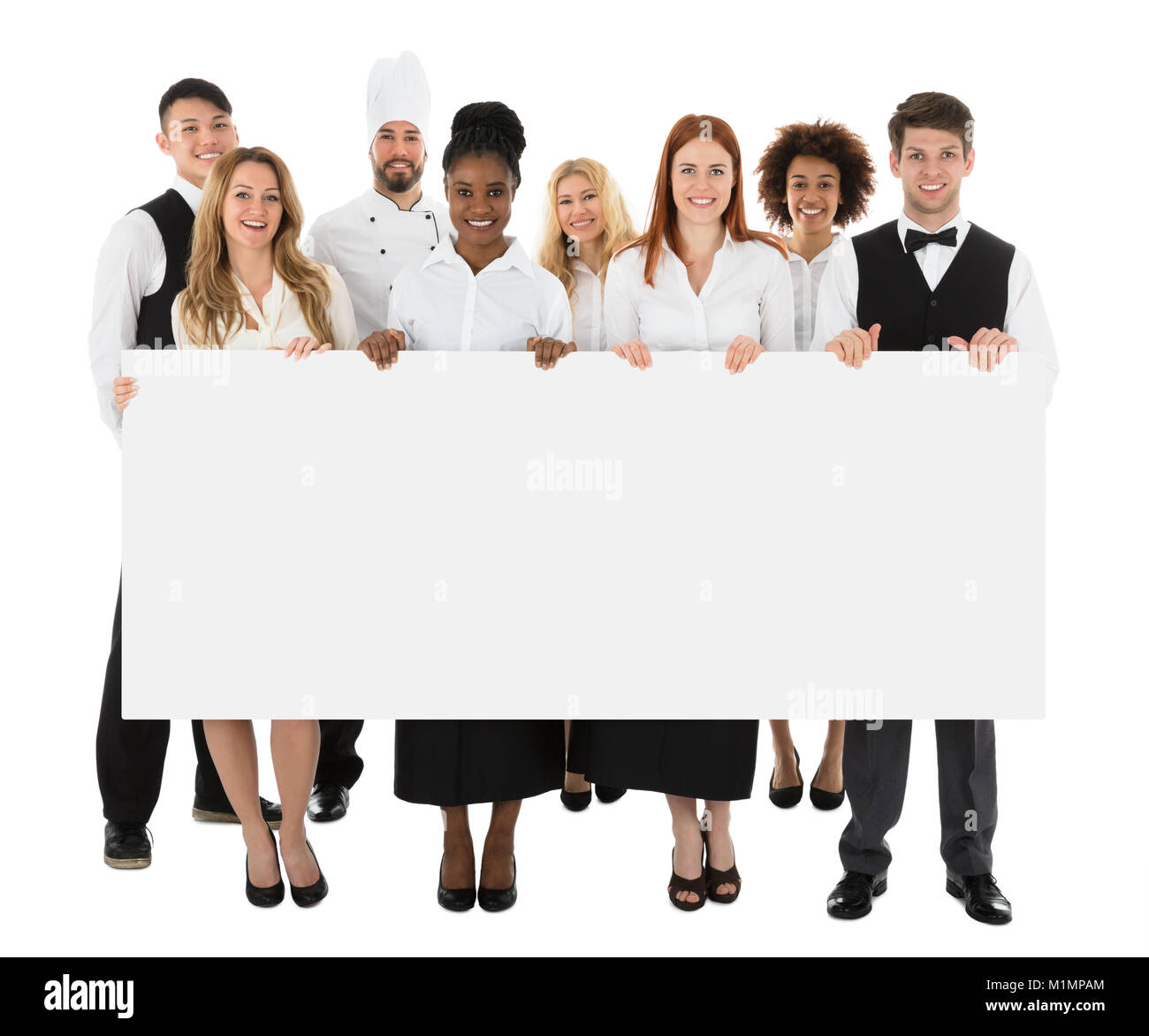 Happy Multiracial Restaurant Staff Holding Long Blank Banner - Stock Image
