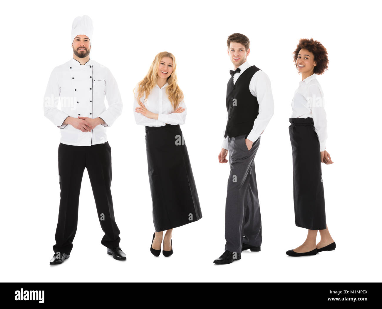 Portrait Of Happy Young Restaurant Staff Standing Over White Background - Stock Image