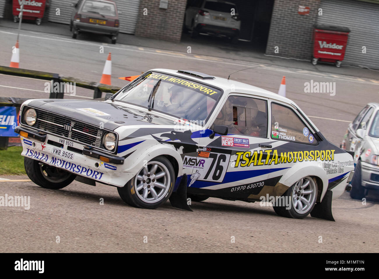 Ford Escort MkII with driver John Carroll and co-driver Linda Thomas at the Motorsport News Circuit Rally Championship, - Stock Image
