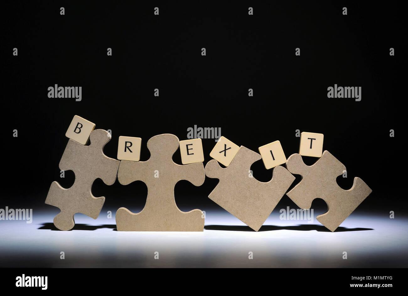 JIGSAW PIECES WITH WORD TILES SPELLING 'BREXIT' RE THE EU EUROPEAN UNION BREXIT LEAVE REFERENDUM ETC UK - Stock Image
