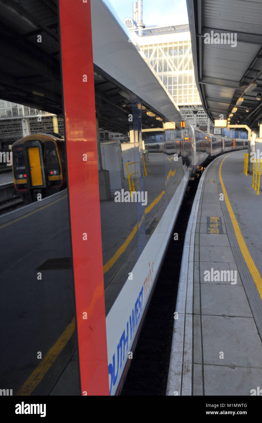 trains in platforms at the London terminal railway station at waterloo. mainline commuting commuter stations in - Stock Image