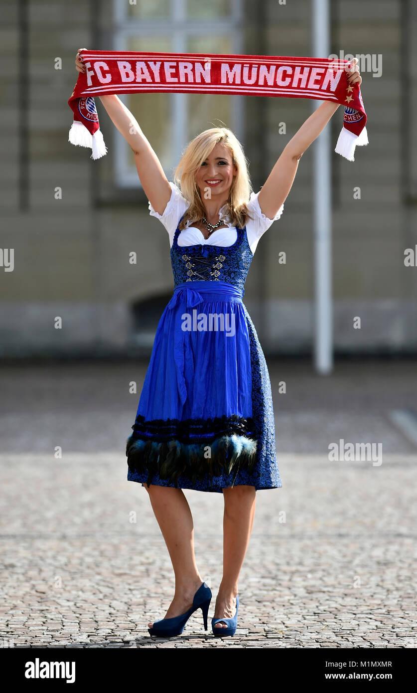 Young woman with a Dirndl, FC Bayern Football scarf, a female fan, Germany, junge Frau mit Dirndl, FC Bayern Fanschal, - Stock Image