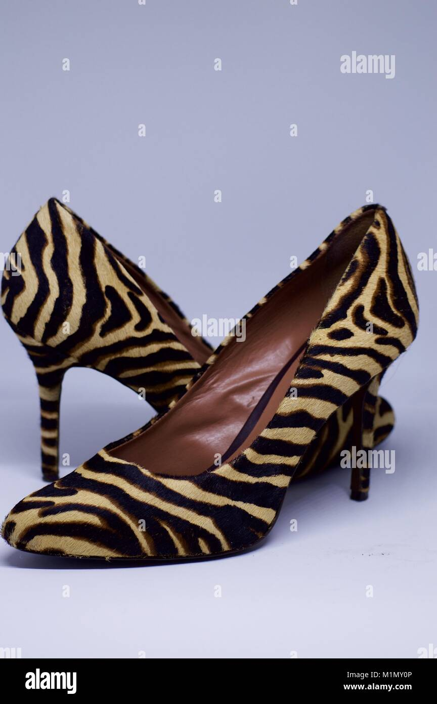 A pair of expensive tiger-skin women's high-heeled shoes - Stock Image