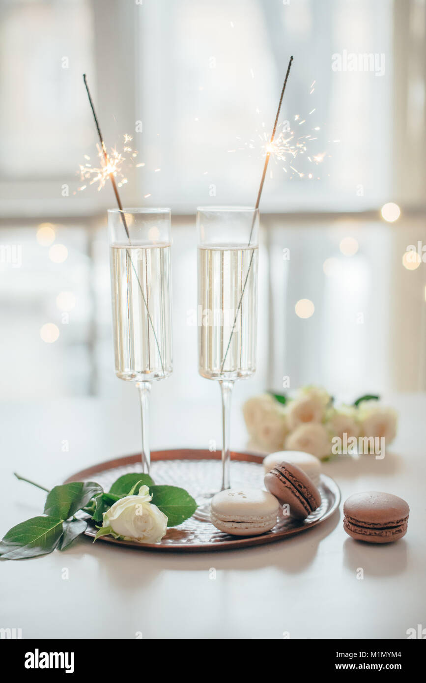 Luxurious champagne wedding party with white roses and macaron d Stock Photo
