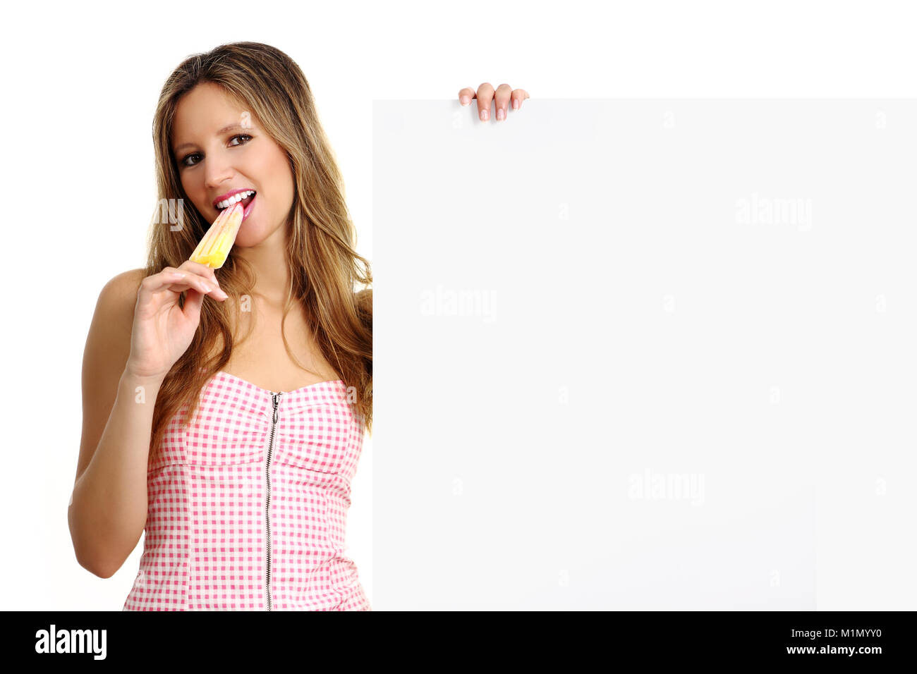 beautiful girl eating a popsicle - Stock Image