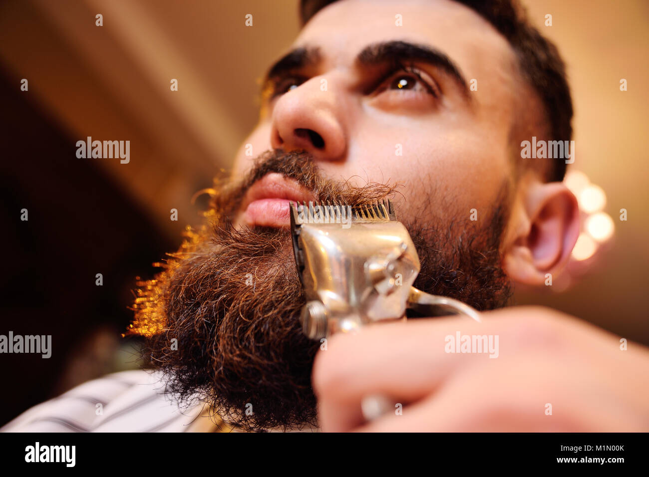 Shaving your beard in barbershop - Stock Image