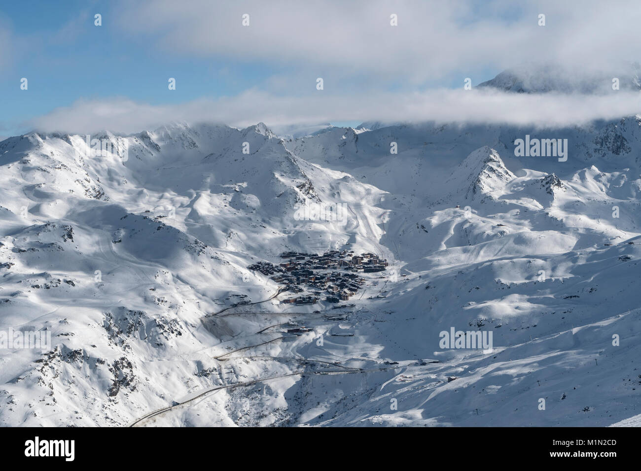 Distant view of the ski resort of Val Thorens in the Belleville Valley in the Three Valleys ski region of France - Stock Image