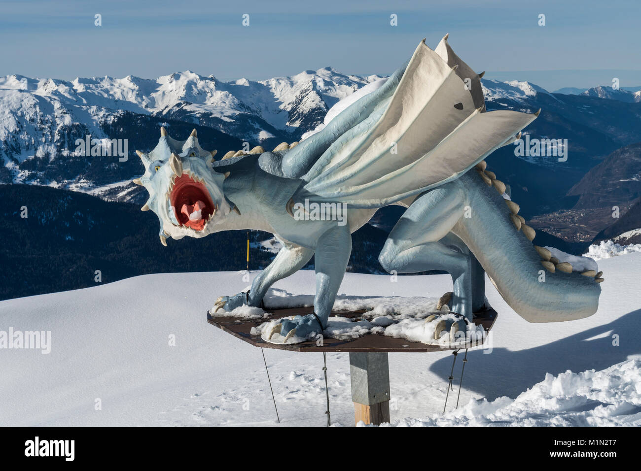 Dragon sculpture beside the Loze piste in the French ski resort of Meribel in the three valleys - Stock Image
