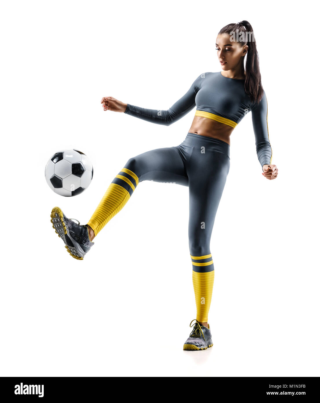 20afbaaaaa7 Football soccer player in action. Photo of sporty woman in sportswear  isolated white background.