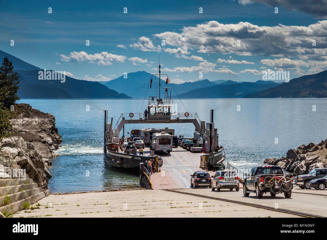 Vehicles entering MV Galena ferry in Shelter Bay to cross Upper Arrow Lake to Galena Bay, Monashee Mtns, West Kootenay, British Columbia, Canada Stock Photo