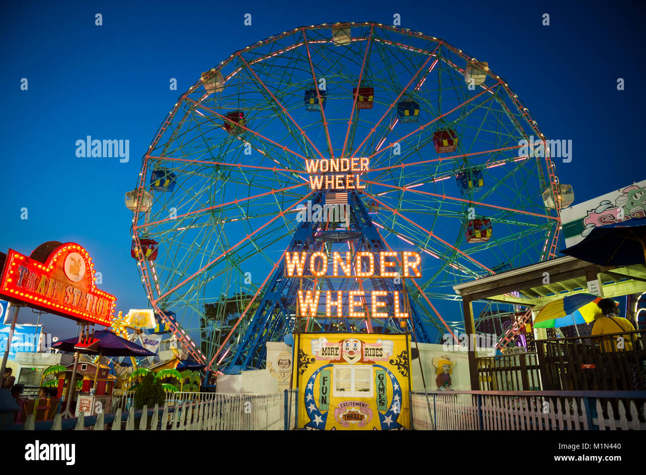 NEW YORK CITY - AUGUST 17, 2017: View from the Coney Island boardwalk of the iconic amusement park Wonder Wheel. - Stock Image