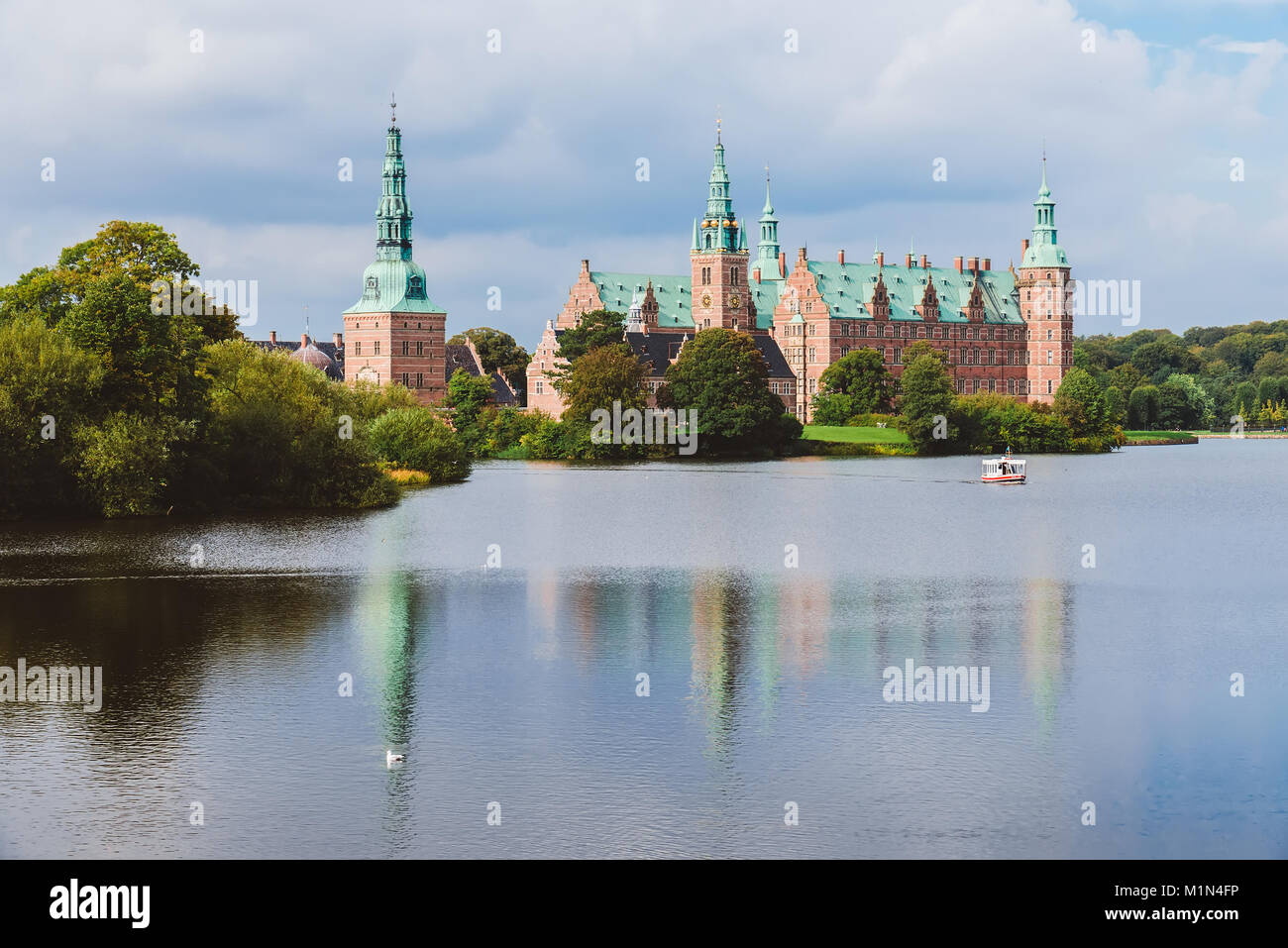 Frederiksborg castle reflected in the lake in Hillerod, Denmark. Renaissance castle and romantic lake near Copenhagen. - Stock Image