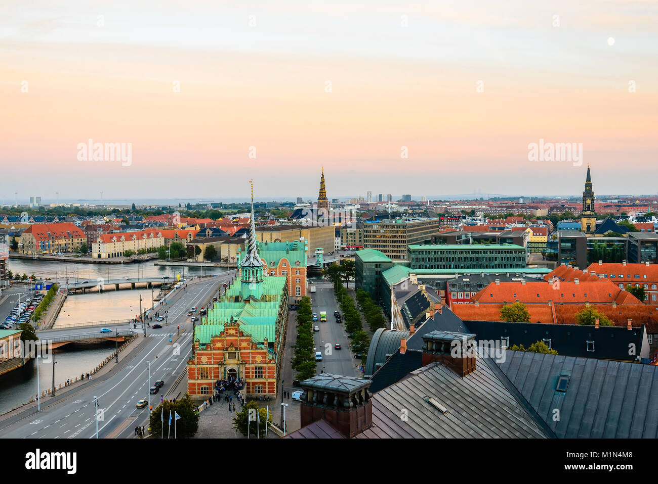 Copenhagen view from above Christiansborg. Our Saviour church spire, old stock exchange building, bridges over canal. - Stock Image