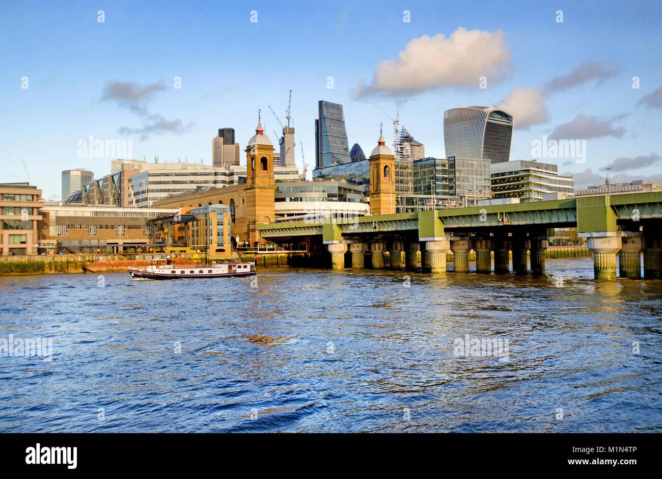 London, England, UK. Cannon Street Rail Bridge and station - The City skyline behind - Stock Image