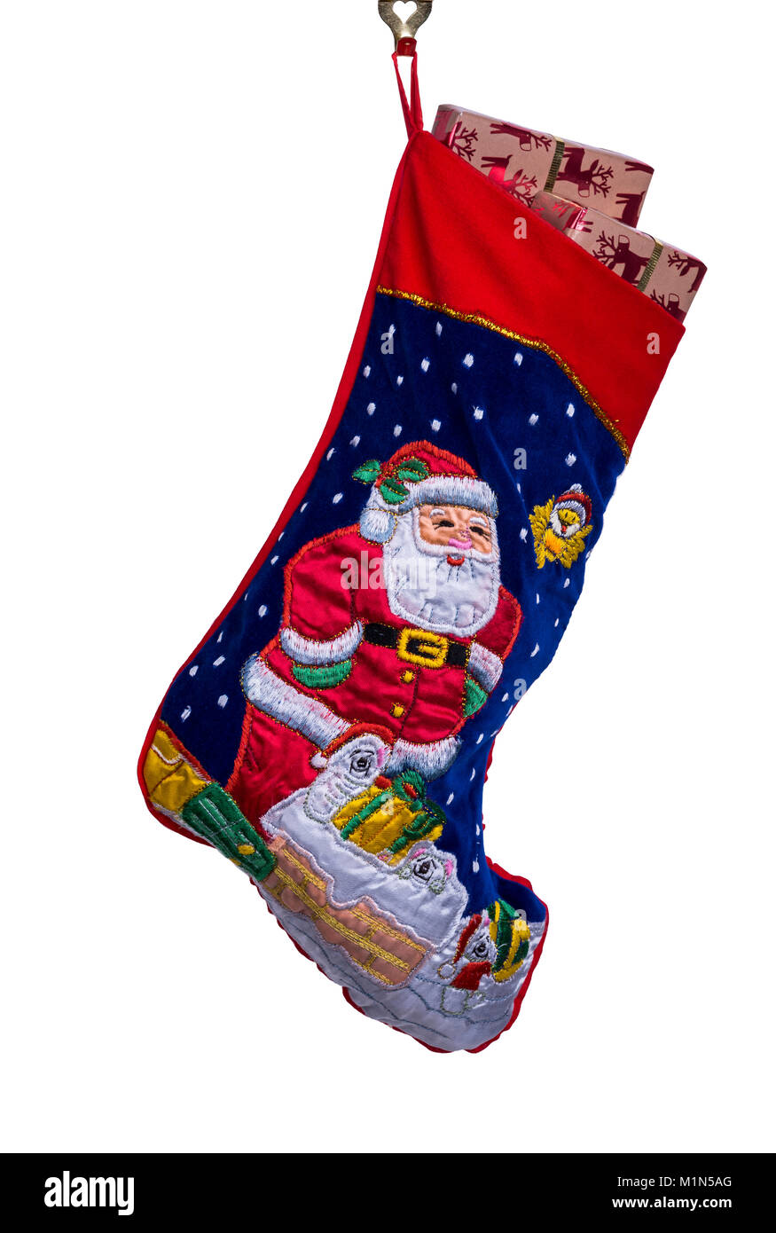 Traditional Christmas or Xmas stocking, filled with gift wrapped presents or gifts. - Stock Image