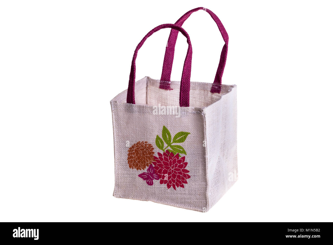 Empty hessian shopping bag, isolated on white. With floral decoration. - Stock Image