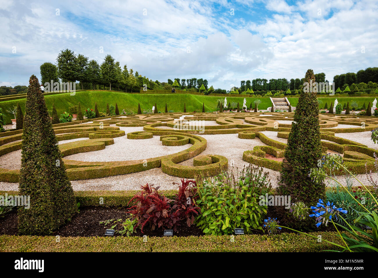 Hillerod, Denmark - September, 23th, 2015. Royal park near Frederiksborg castle. Baroque garden with green trees, - Stock Image