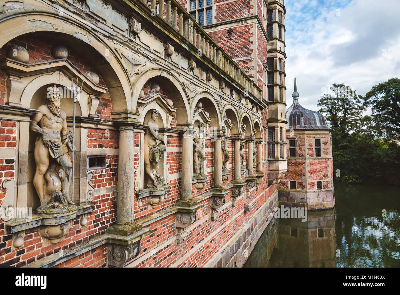 Antique sculptures near entrance to Frederiksborg castle in Cope - Stock Image