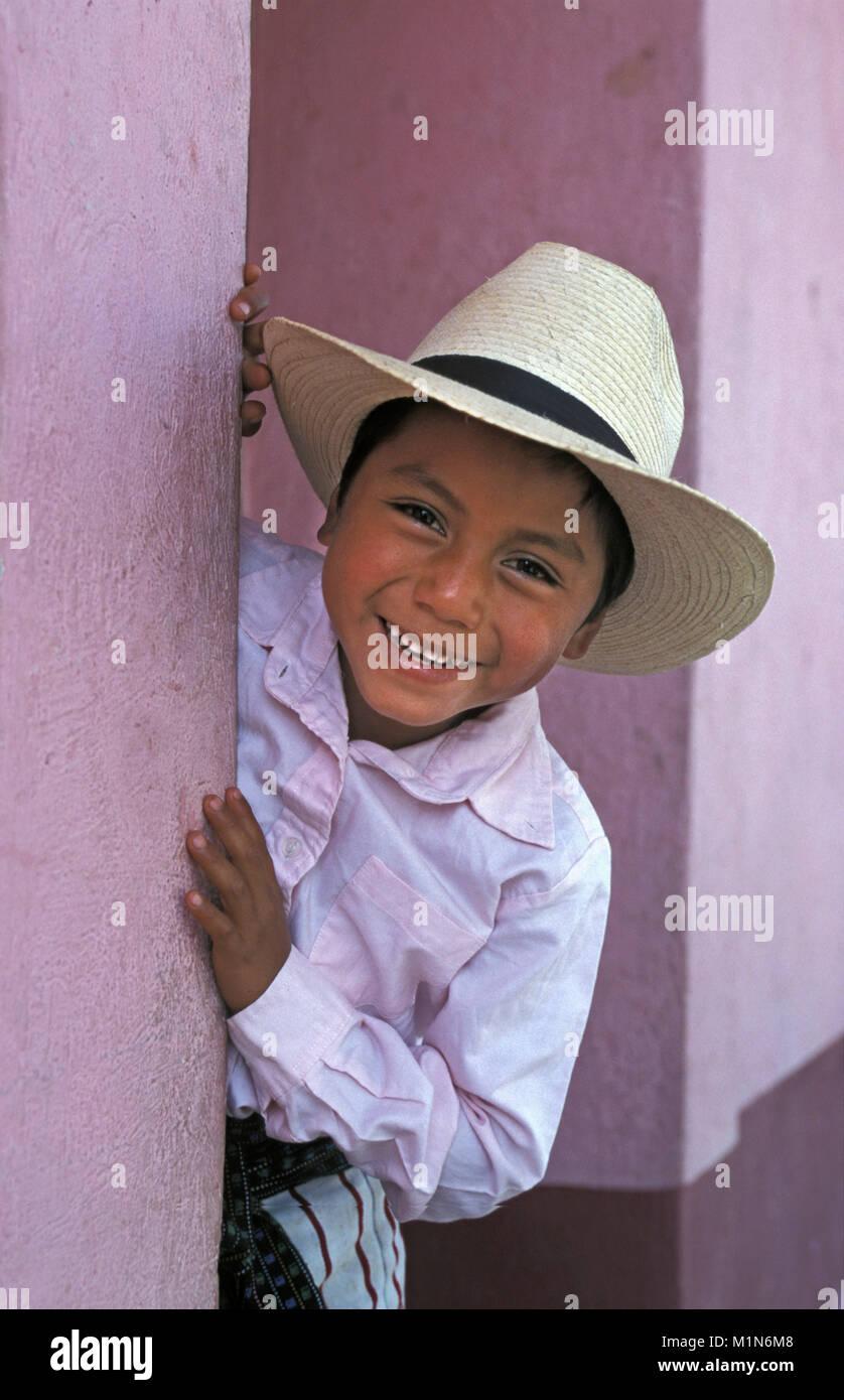 Guatemala. Santiago de Atitlšn. Lago de Atitlan. Maya indian wearing hat. Boy. Portrait. - Stock Image
