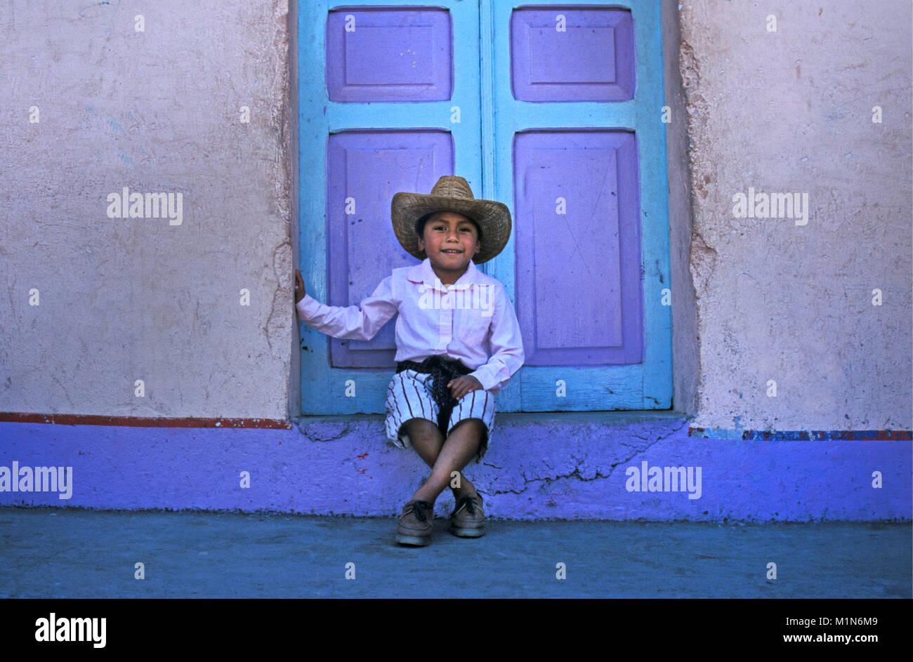Guatemala. Santiago de Atitlšn. Lago de Atitlan. Maya indian sitting in window. Boy. Portrait. - Stock Image