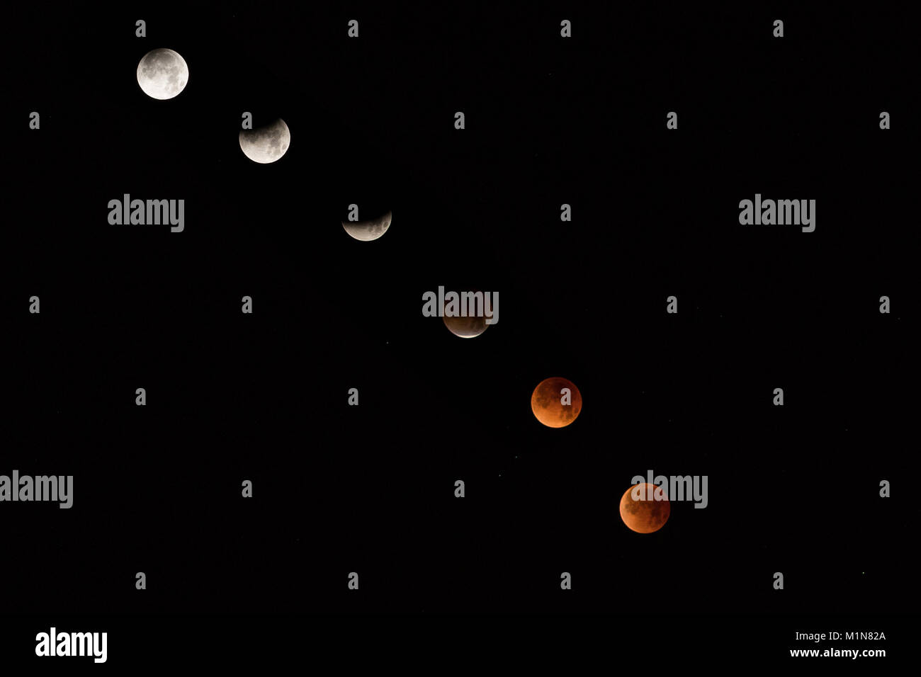 A composite image of the phases of the Super Blue Blood Moon as seen from Manhattan Beach, California on January - Stock Image