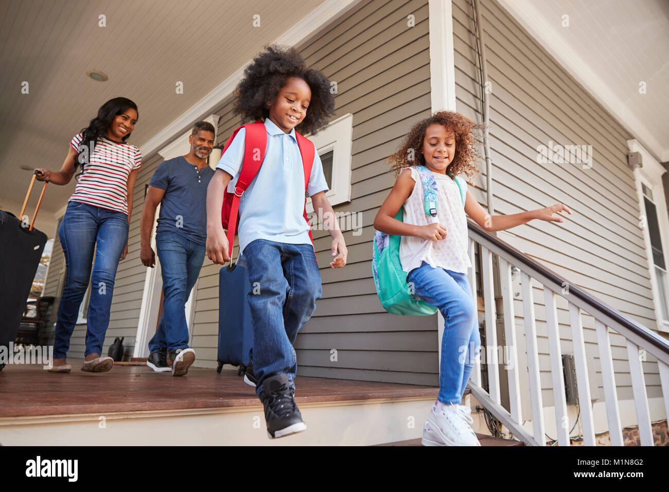 Family With Luggage Leaving House For Vacation - Stock Image