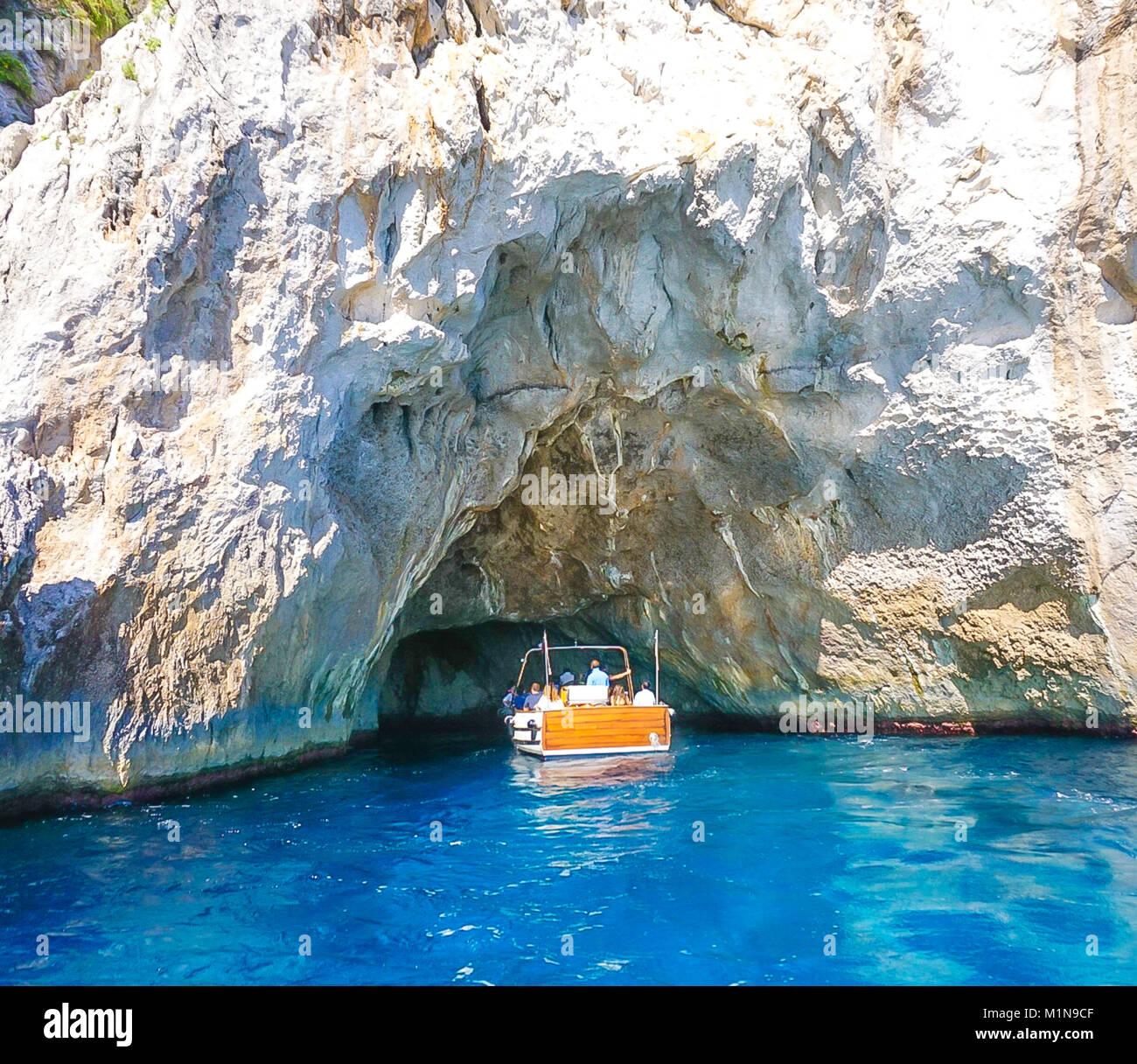 The White Grotto of the island of Capri, Italy.  Coastal Rocks on the Mediterranean Sea at Capri Island from a motor boat tour. Stock Photo