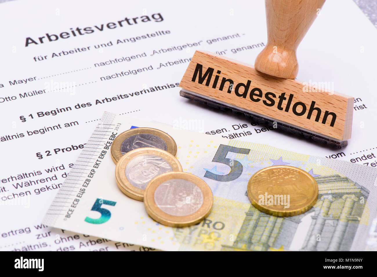 minimum wages in Germany with 8,50 Euros and employment contract Stock Photo