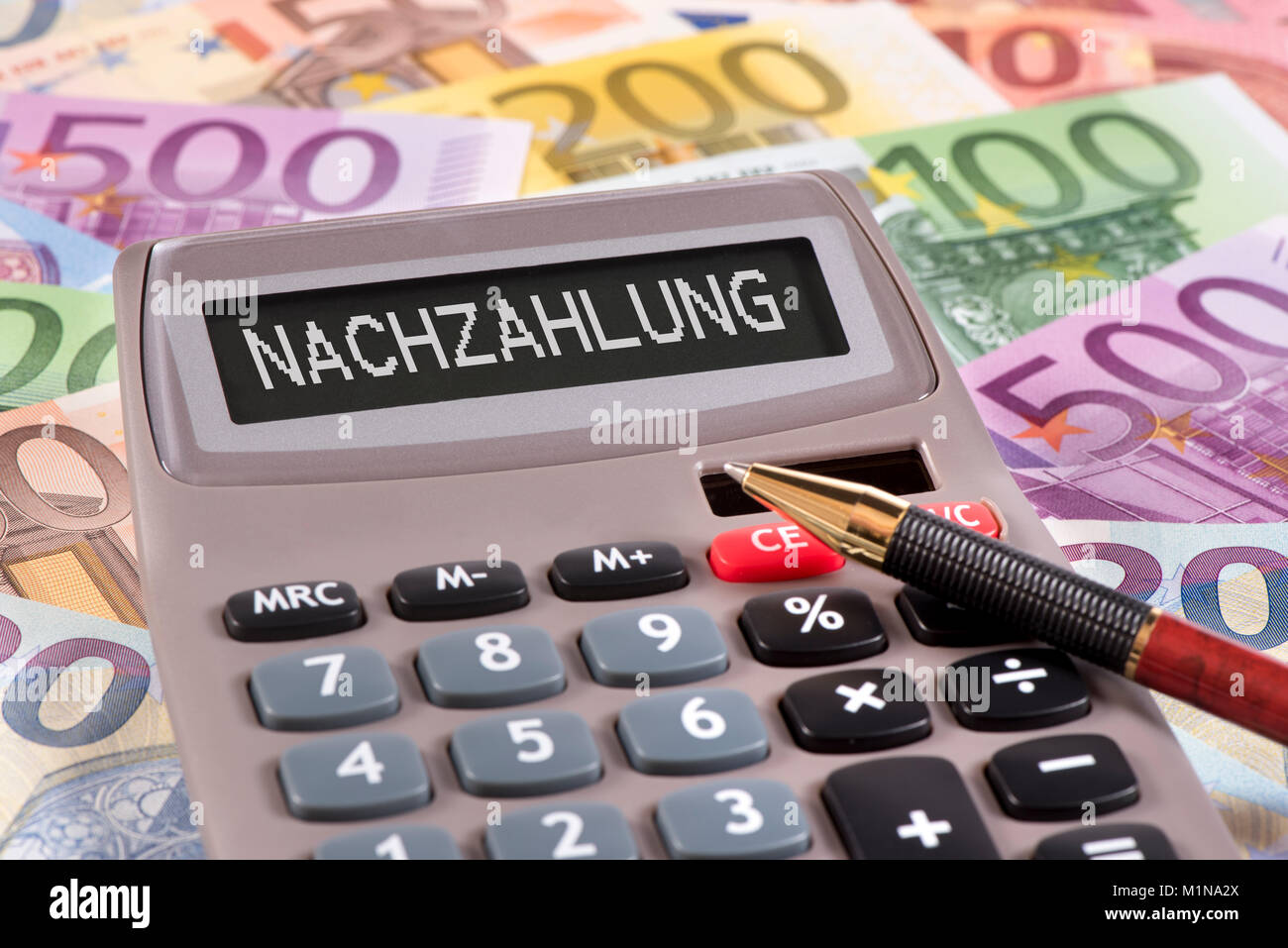 Taschenrechner mit Aufschrift Nachzahlung - Stock Image