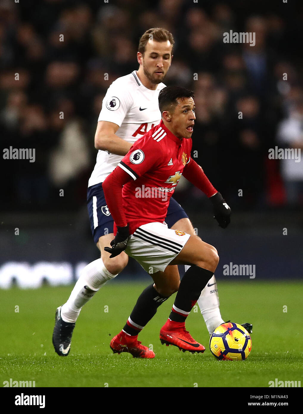 029f5628ddf8 Tottenham Hotspur s Harry Kane (left) and Manchester United s Alexis  Sanchez (right) battle