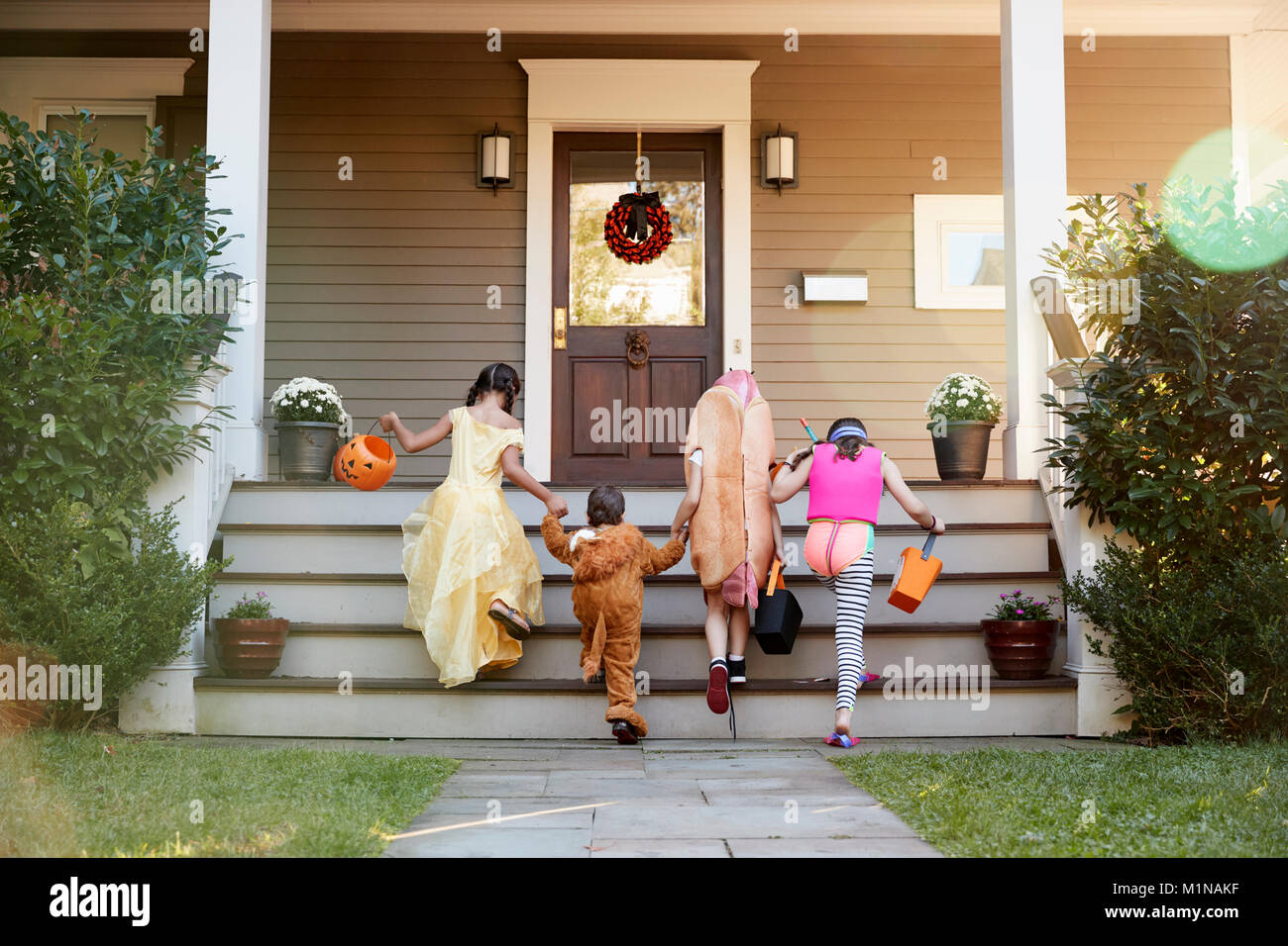 Children Wearing Halloween Costumes For Trick Or Treating - Stock Image