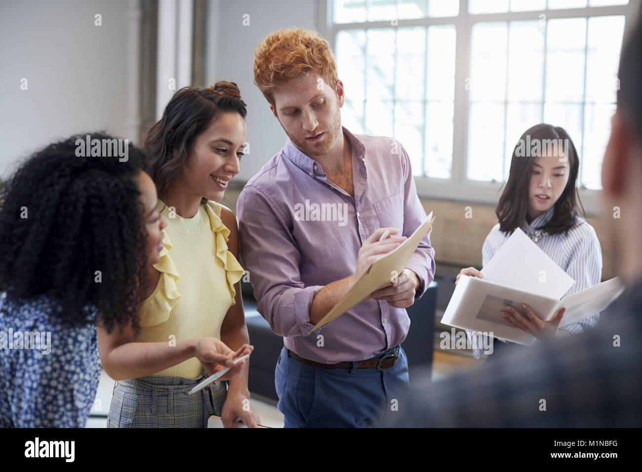 Young creatives discussing brainstorm ideas, close up - Stock Image