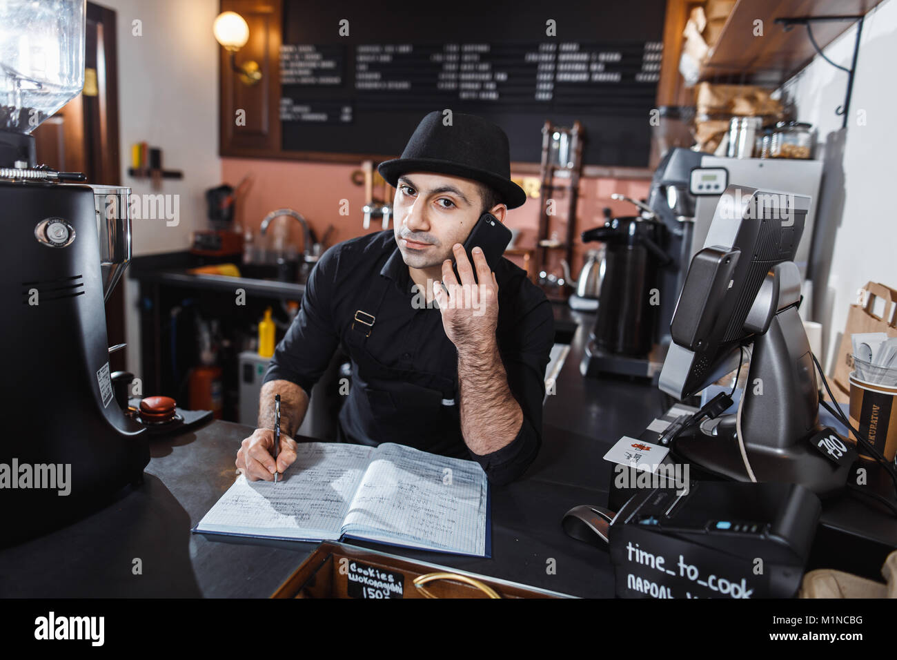 Barista make order - Stock Image