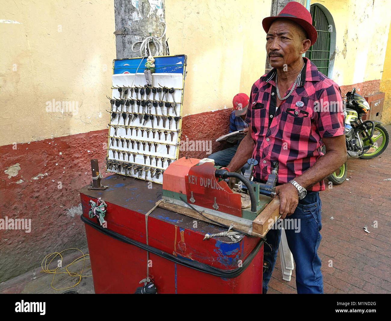 Cartagena, Colombia - January 24th, 2018: A Colombian locksmith working on the street at the Old Town in Cartagena. - Stock Image