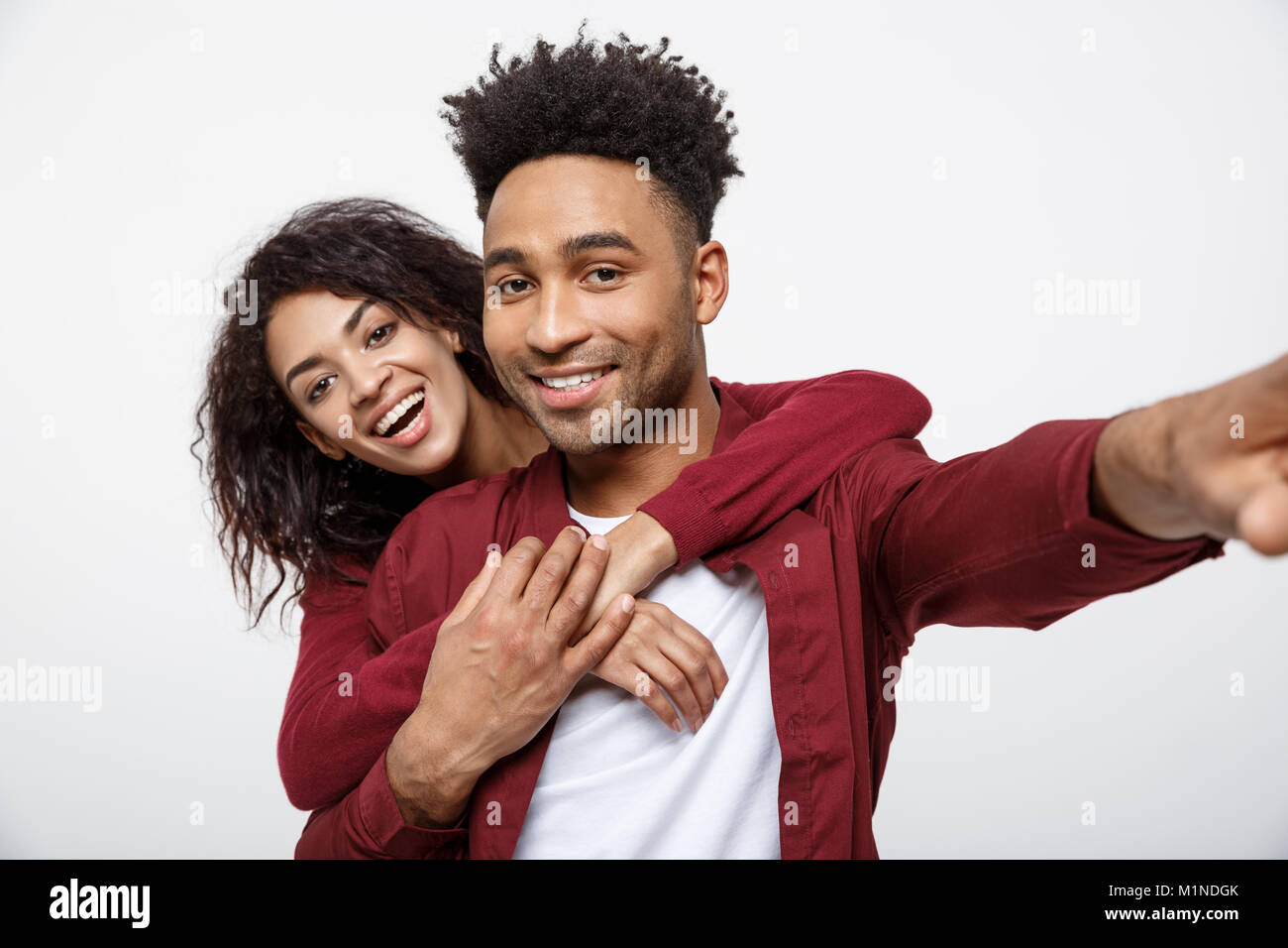 Close up attractive African American couple making a selfie with cute gesture. - Stock Image