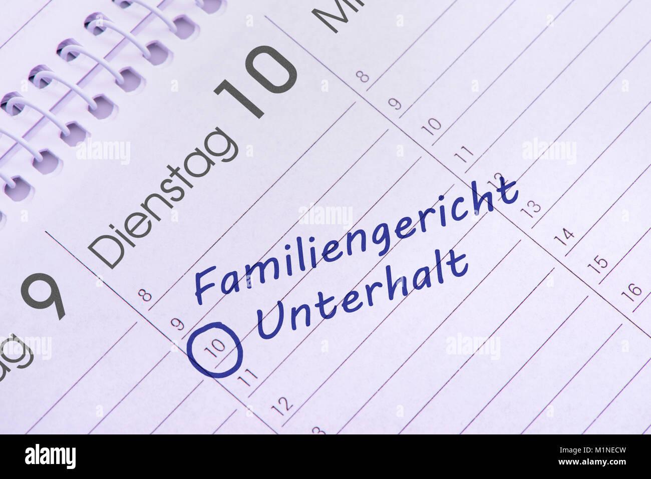 Familiengericht und Unterhalt als Eintrag im TerminkalenderTerminkalender mit Eintrag - Stock Image