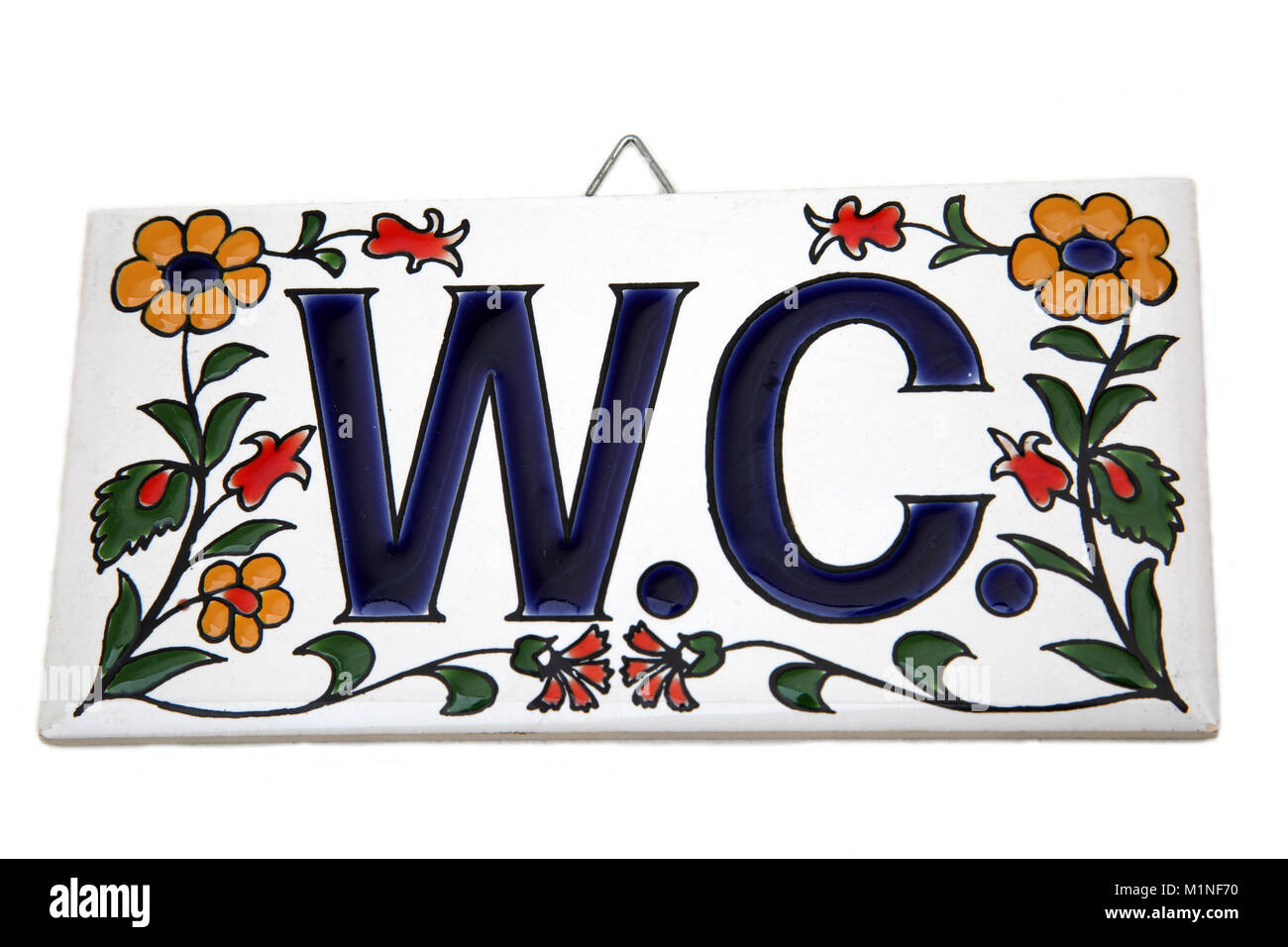 Floral Porcelain W.C (Water Closet) Plaque - Stock Image