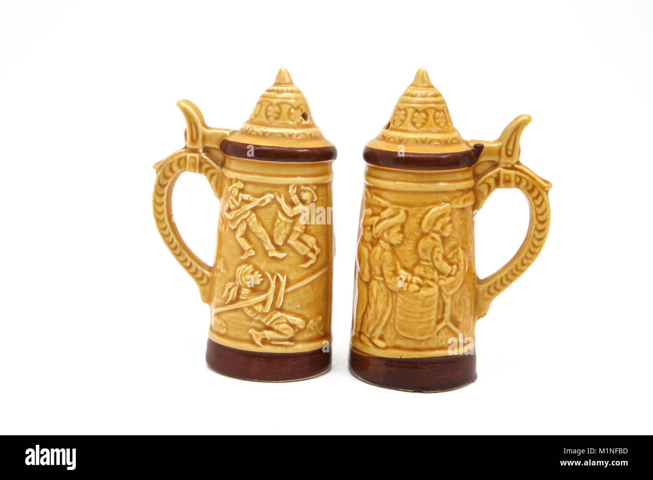 Stein Salt and Pepper Shakers made in Japan Decorated with the Trinidad Limbo Dance and Steel Drums - Stock Image