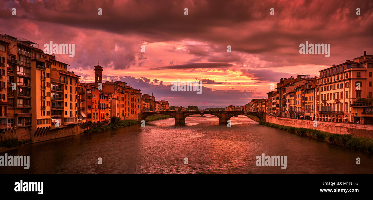 FLORENCE, ITALY - MAY 19, 2017: Beautiful view of Saint Trinity bridge from Ponte Vecchio at sunset in Florence, - Stock Image