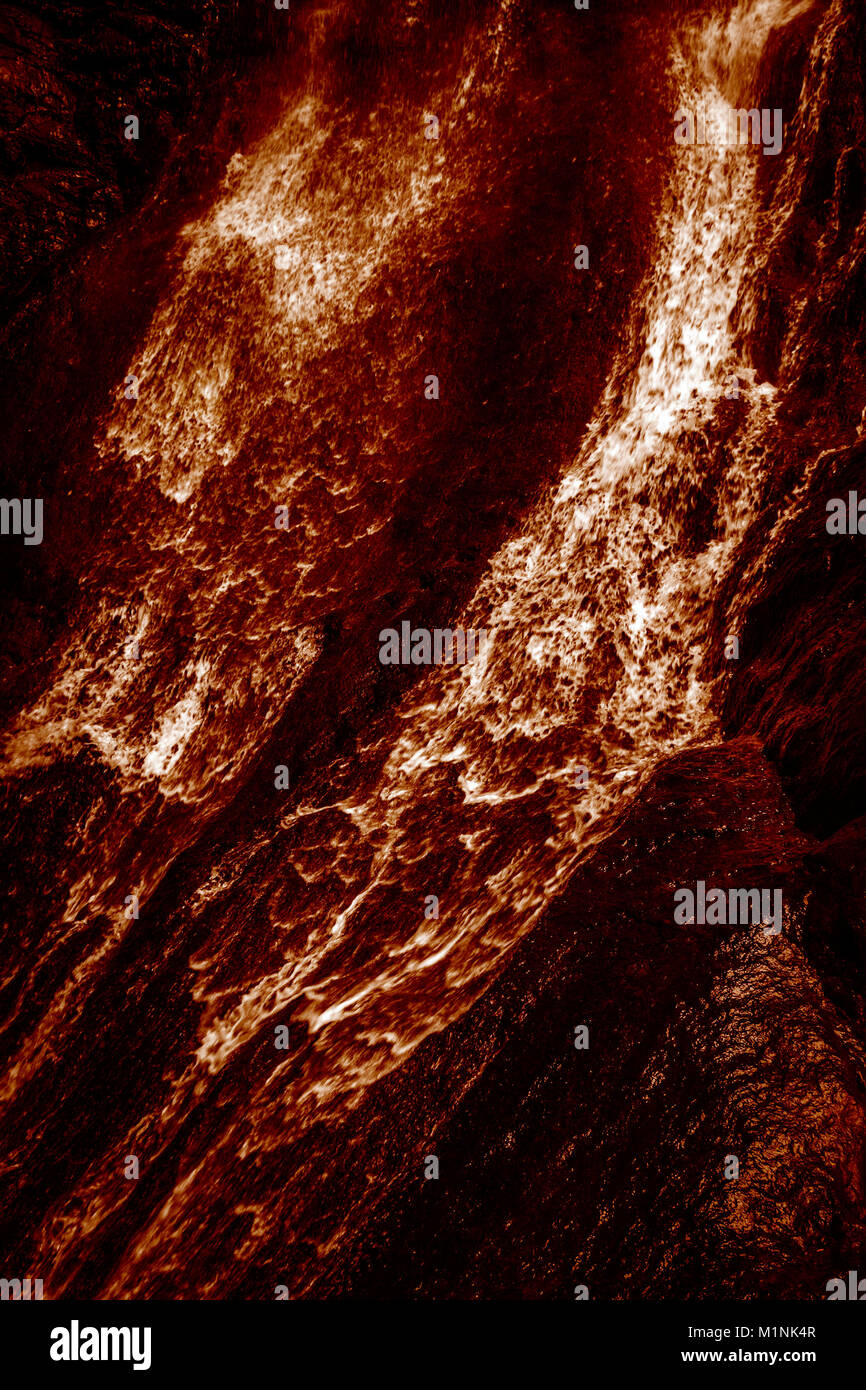 The hot lava flows down. Photographic effect. - Stock Image