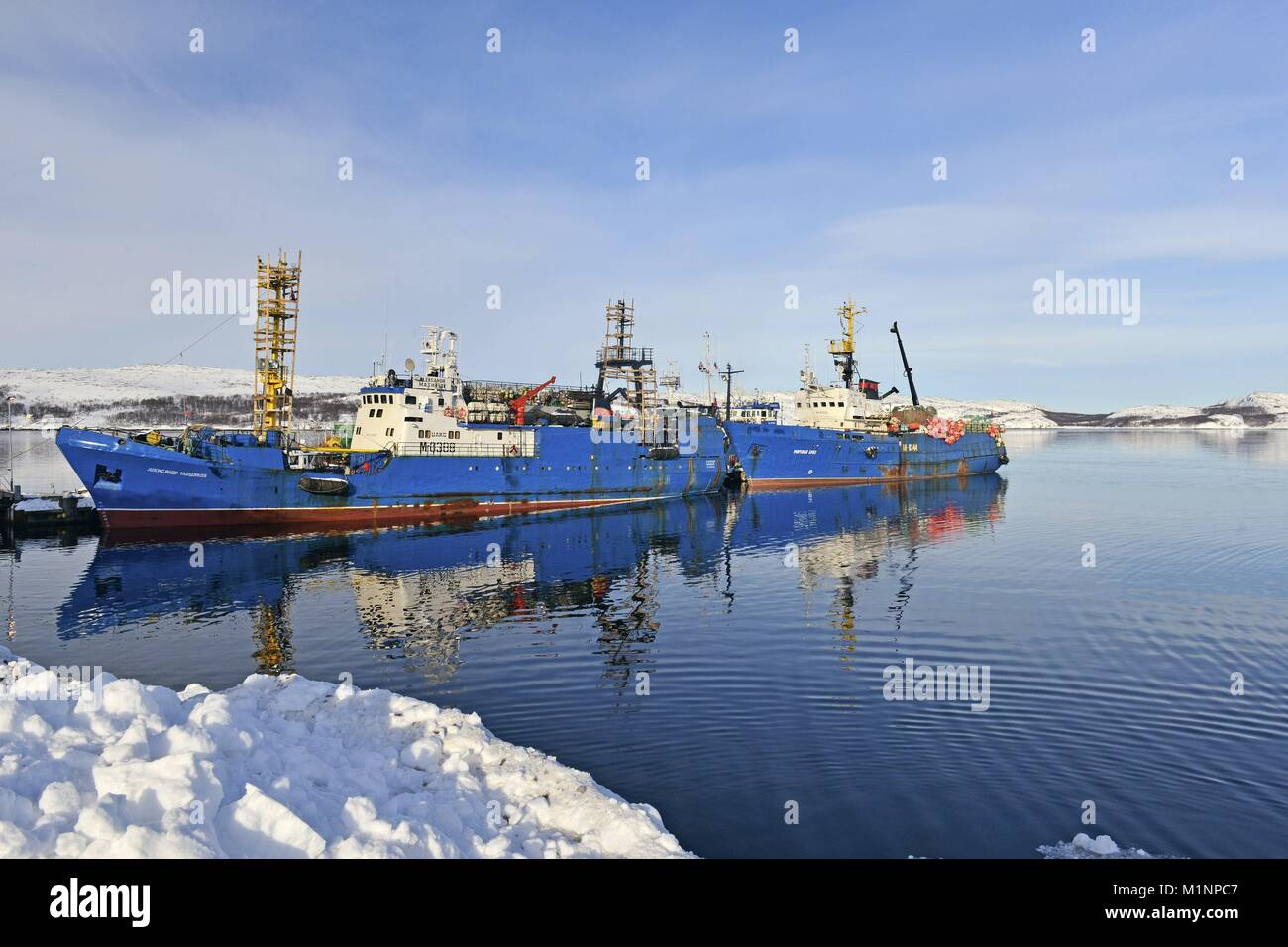 Blue hulls from two Russian trawlers at the jetty in the Norwegian town Kirkenes, 8 March 2017 | usage worldwide Stock Photo