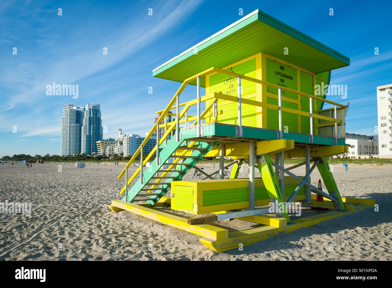 Scenic morning view of an iconic colorful lifeguard tower on South Beach, Miami - Stock Image