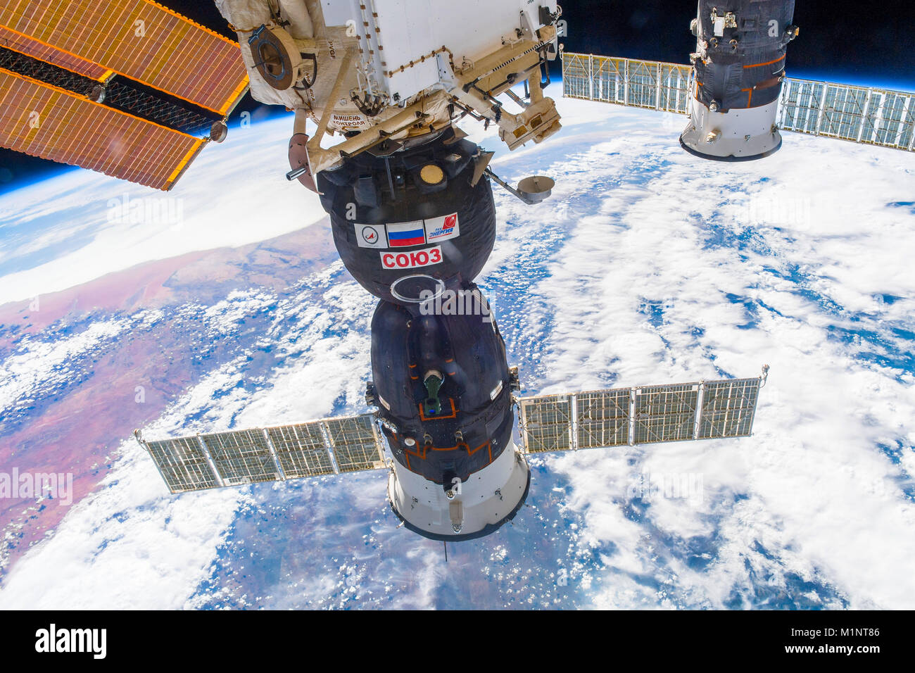 Outer Space-December 30, 2017: Awesome view of the planet Earth and the Soyuz spaceship docked to the ISS. This - Stock Image