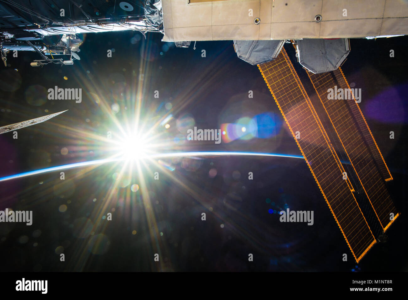 Awesome sunlight in space. The sun is seen from the ISS or International Space Station. This image elements furnished - Stock Image
