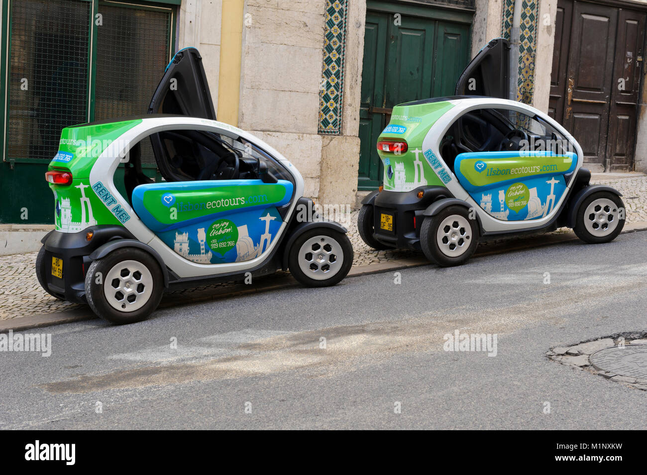 Small ecotour cars parked on one of the streets in Lisbon, Portugal - Stock Image