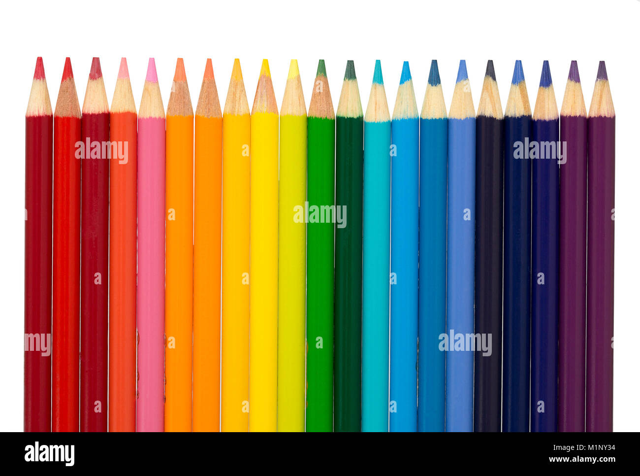 A group of color pencils arranged in the color scheme of a rainbow- red, orange, yellow, green, blue indigo, and - Stock Image
