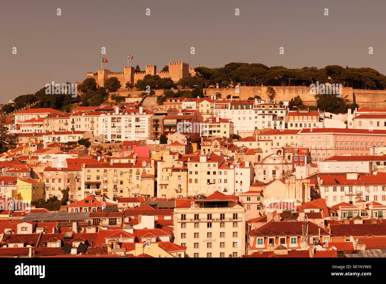 View over the old town to Castelo de Sao Jorge castle at sunset, Lisbon, Portugal, Europe - Stock Image